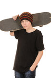 O adolescente com um skate Fotografia de Stock Royalty Free