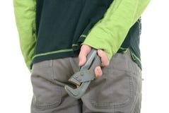 O adolescente esconde a chave da trombeta fotografia de stock royalty free