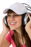 O adolescente fêmea feliz aprecia a música imagens de stock