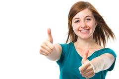 O adolescente fêmea mostra os polegares acima Fotografia de Stock Royalty Free