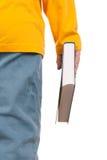 O adolescente mantem o livro disponivel imagens de stock royalty free