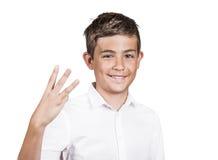 O adolescente que mostra três dedos, numera o gesto três imagem de stock royalty free