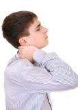 O adolescente sente Neckache Foto de Stock Royalty Free