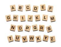 O alfabeto esquadra as telhas de madeira Fotos de Stock