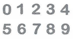 O alfabeto, numera 0-9 com textura de pedra Fotografia de Stock