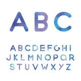 O alfabeto pitoresco em máscaras azuis Fotos de Stock Royalty Free