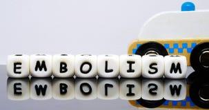O alfabeto rotula a soletração de um embolismo da palavra Imagens de Stock
