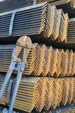 O alicate da estaca e a pilha de aço do ângulo. Imagem de Stock