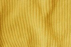 O amarelo fez malha o fundo do teste padrão da tela de lã fotografia de stock royalty free