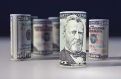 O americano 50 dólares de dólar rolou acima no preto Imagem de Stock Royalty Free