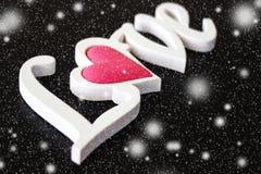 O amor da palavra em um preto Fotos de Stock Royalty Free