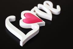 O amor da palavra em um preto Foto de Stock