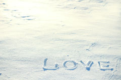 O amor da palavra tirado na neve Fotos de Stock