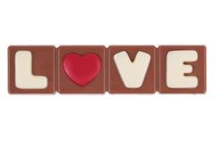 O amor e o coração da palavra para uma barra de chocolate Imagens de Stock Royalty Free