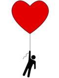 O amor levanta-nos acima do símbolo da pessoa do balão do coração Fotografia de Stock