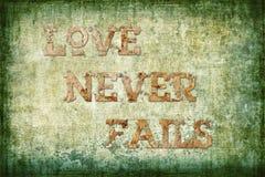 O amor nunca falha o fundo religioso Fotografia de Stock