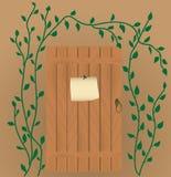 O anúncio na porta de madeira Fotos de Stock