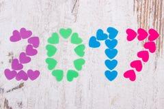 O ano novo feliz 2017 fez de corações coloridos Imagens de Stock