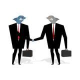 O aperto de mão dos tubarões do negócio faz o negócio Os profissionais agitam as mãos Foto de Stock