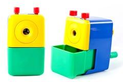 O apontador mecânico gerencie com verde amarelo azul da mão isolado no fundo branco Fotos de Stock Royalty Free