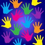 O arco-íris caçoa as mãos Imagens de Stock