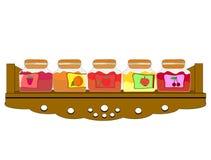 O armário da prateleira encheu-se com os frascos do atolamento Fotos de Stock Royalty Free
