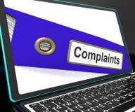 O arquivo das queixas no portátil mostra queixas Fotografia de Stock