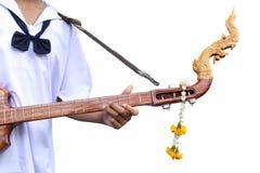 O artista de Studen que joga Phin amarrou o instrumento arrancado fotos de stock