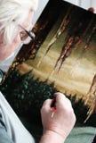 O artista desenha um retrato Fotografia de Stock