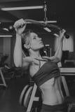 O atleta no gym foto de stock royalty free