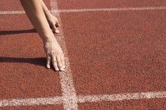 O atleta nos blocos começar, apronta-se para ir Imagem de Stock Royalty Free
