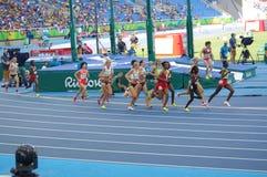 O atletismo 5000m das mulheres corridos Imagens de Stock