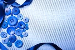 O azul abotoa o fundo Foto de Stock