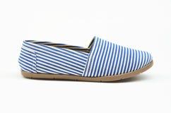 O azul calça alpergatas Imagens de Stock Royalty Free