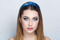 O azul da mulher compõe foto de stock royalty free