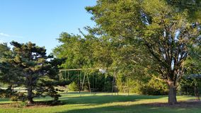 O balanço ajustado no parque Imagem de Stock Royalty Free