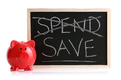 O banco Piggy gasta ou conserva Foto de Stock