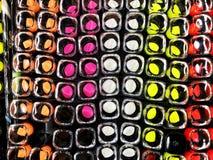 O batom dos anúncios do batom do encanto na cor diferente tonifica Produto da promoção do pacote Foto de Stock Royalty Free