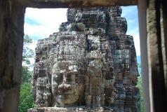 Bayon enfrenta, templos de Angkor, Cambodia Foto de Stock