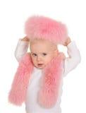 O bebé bonito vestiu-se no jogo cor-de-rosa da pele no fundo branco Fotos de Stock Royalty Free