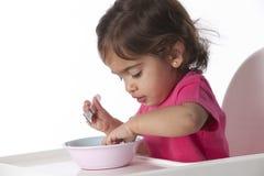 O bebé está comendo só Imagem de Stock Royalty Free