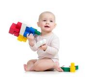 O bebé que joga com construção ajustou-se sobre o fundo branco Imagens de Stock Royalty Free