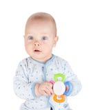 O bebê bonito está guardando o brinquedo imagens de stock royalty free