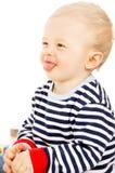 O bebê bonito mostra a língua foto de stock royalty free