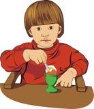 O bebê come o ovo Imagem de Stock