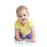O bebê engraçado vai para baixo em todos os fours Imagem de Stock Royalty Free