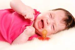 O bebê está gritando Fotografia de Stock