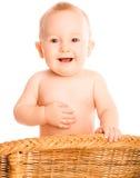 O bebê feliz afaga o estômago fotos de stock