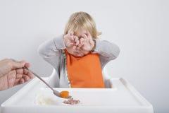 O bebê não gosta da cenoura Fotografia de Stock Royalty Free