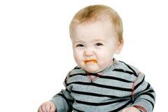 O bebê não gosta de cenouras Fotografia de Stock Royalty Free